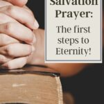 hands clasped together on top of a bible with a text box that says the salvation prayer