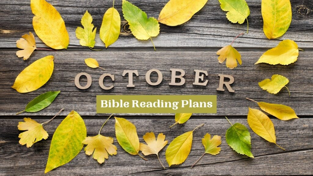 October Bible Reading Plans written on a wooden backdrop surrounded by yellow leaves