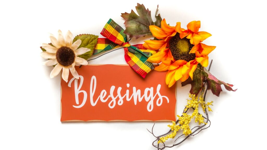 Blessed written on a note with fall flowers